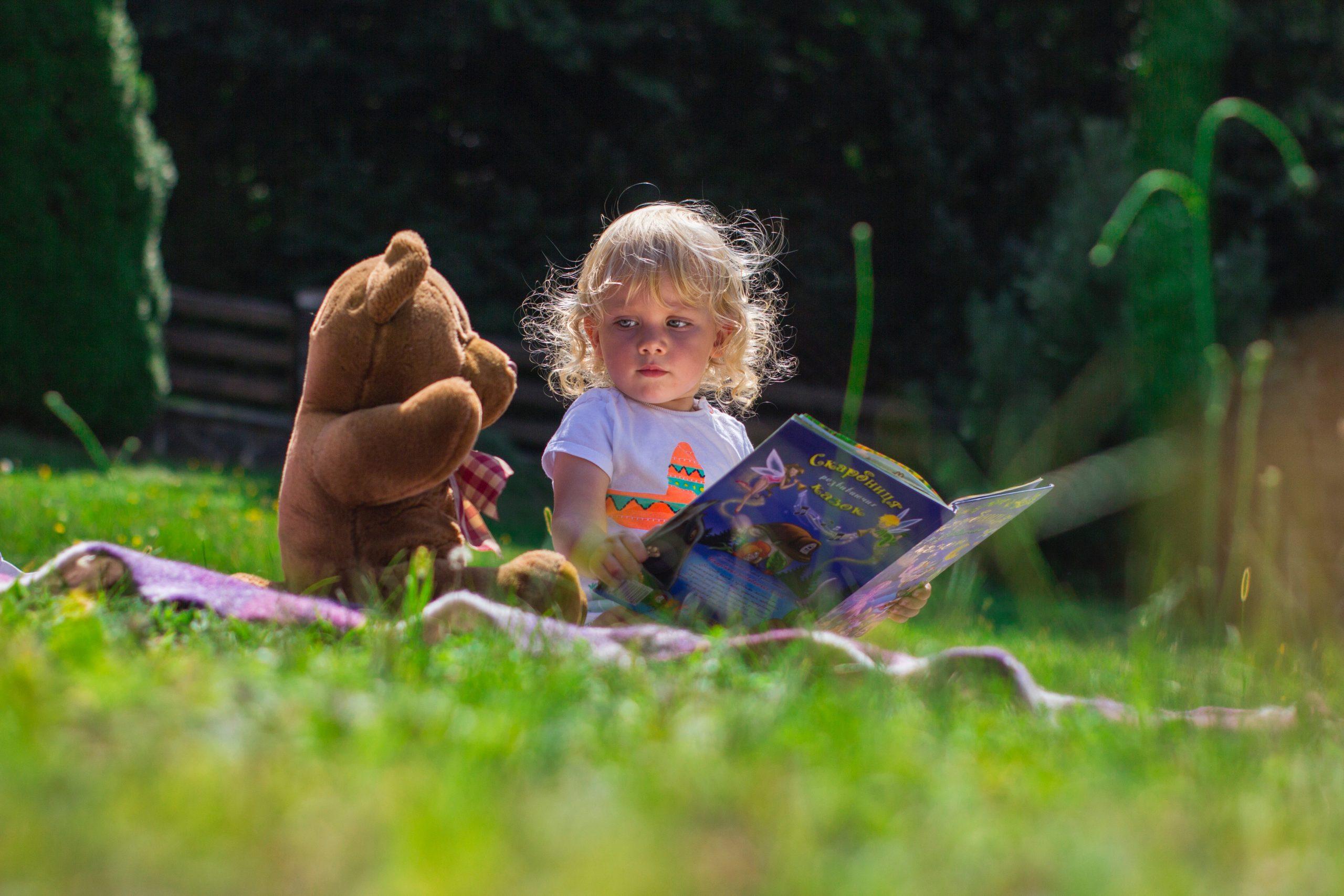 girl-sitting-beside-a-teddy-bear-2803979 copy