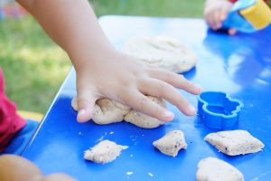 photo-of-child-s-hand-playing-clay-2425817 copy